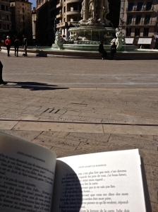 Casually reading by the fountain